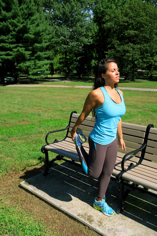 Stretching The Quads Helps Warm Up Your Legs Before A Workout